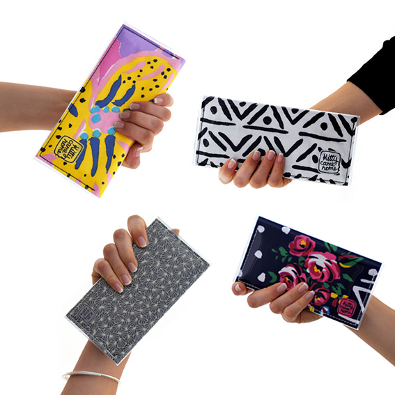 A photograph of four different hands each holding a differently styled purse